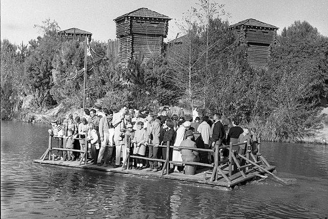 Photo of people on a raft to Tom Sawyer Island at Disneyland, about 1960